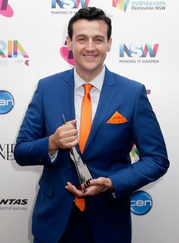 Sam Moran with his ARIA for Best Children's Album.