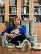 Curious cats: Kristen Alexander cuddles Miss Millie.