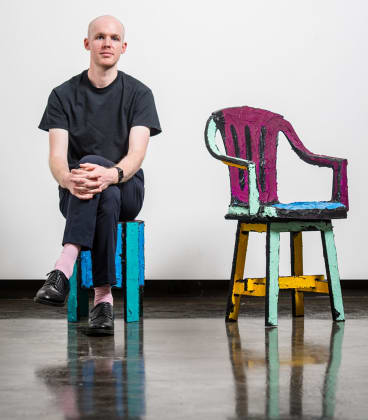Dale Hardiman with his work for design week 2018 at Sophie Gannon Gallery in Richmond. Hardiman repairs broken and discarded furniture to create bespoke pieces.