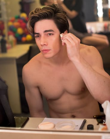 Jakob Ambrose applies his make-up during the tech rehearsals in Melbourne.