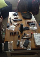 Firearms paraphernalia found in his mother's home in Windsor.