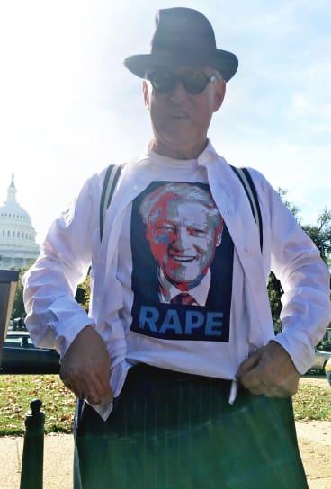 The money shot: Roger Stone reveals the Bill Clinton T-shirt under his suit.