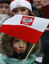Protesters take part in an anti-government demonstration in Warsaw, Poland to protest against the role that President Andrzej Duda and the new conservative government have had in the swelling discord.