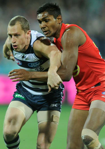 Geelong's James Kelly battles with Timmy Sumner in 2013.