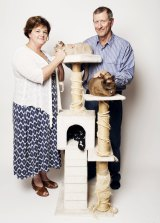 Feline fine: Nick and Tara Killen with their cats Bella (top) and Sookie.