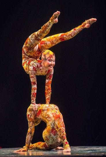 Cirque du Soleil contortionists perform in Kooza.