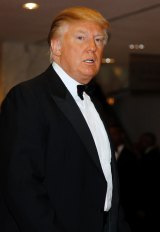 Trump, pictured at the White House Correspondents Dinner in 2011, said he will not go this year.