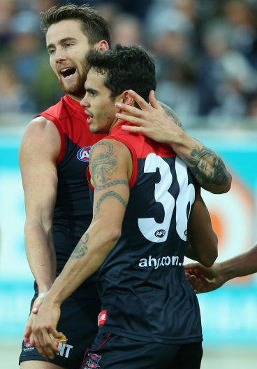 Jeremy Howe and Jeff Garlett of the Demons celebrate a goal.