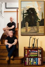 On the stairs: Eyes and Elliott with their favourite painting, Rick Amor's <i>The Gateway (The Man Who Walked Away)</i>.
