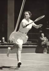 Thelma Long in full flight at Wimbeldon in 1956.