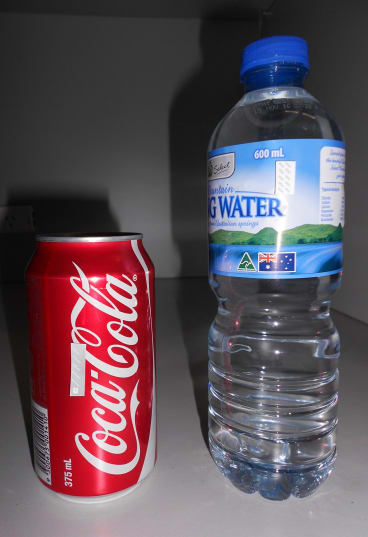 Chipless RFID tags attached to a can of Coke and a bottle of water.