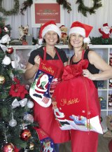 Deborah Quinn, right, from The Christmas Cart, which specialises in personalised messages and images on gifts.