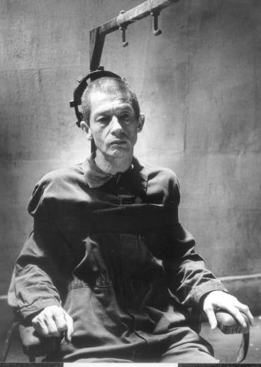 "John Hurt as Winston Smith in the British film ""1984"" (1984)."