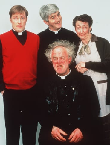 Ardal O'Hanlon (Father Dougal), Dermot Morgan (Father Ted), Pauline McLynn (Mrs Doyle) and Frank Kelly (Father Jack) in <i>Father Ted</i>.