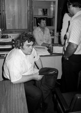 Jimmy Breslin sits at police headquarters in New York after the arrest of David Berkowitz, the Son of Sam serial killer suspect who had contacted Breslin with several cryptic messages during the killing spree.