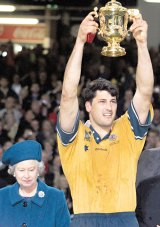 Triumph: John Eales with the 1999 World Cup after defeating France in the final.