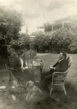 Taking tea in the garden: William Robert Guilfoyle with his wife Alice (c.1903), son and dog.