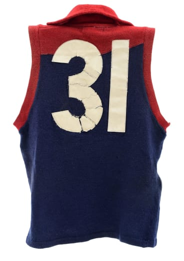 Ron Barassi's famous No. 31 Melbourne jumper from the 1964 season, in match-worn condition. Estimate: $20,000 to $40,000.