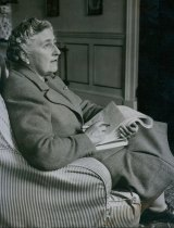 Agatha Christie correcting proofs of one of her books in her study at Greenway House.