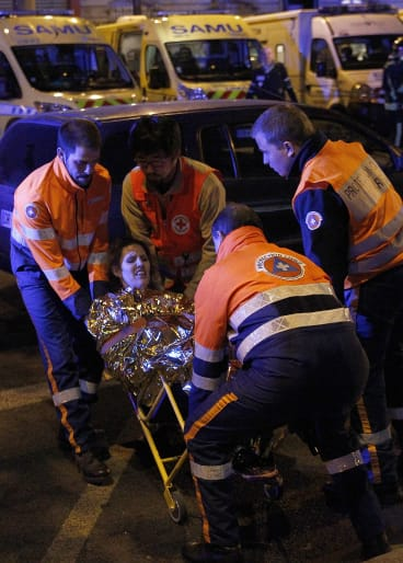An injured woman is rescued near Le Bataclan.