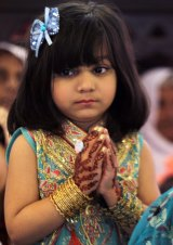 A girl prays during an Easter service at St Anthony's Church in Lahore.