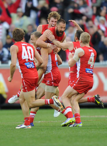 Sydney Swan Nick Malceski celebrates with teammates after kicking the winning goal in the 2012 AFL grand final.