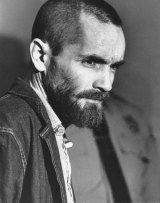 Charles Manson arrives in a courtroom in Los Angeles, California on March 5, 1971