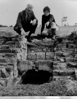 Judy Birmingham shows part of an excavated kiln to the Hunter Water president at an archaeological dig on June 6, 1969.
