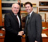 With his then employer, prime minister John Howard, in Canberra in 2004.