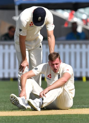 Jake Ball sits injured during day two of England's match against the Cricket Australia XI in Adelaide.