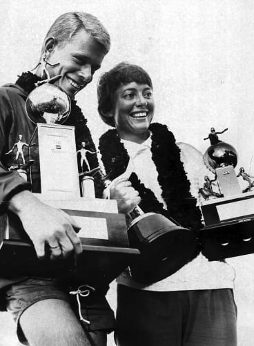 The best: Australian surfers Midget Farrelly and Phyllis O'Donnell with their world championship trophies.