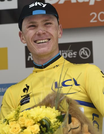 Sky's Chris Froome dons the yellow jersey at the end of the Criterium du Dauphiné on Sunday.