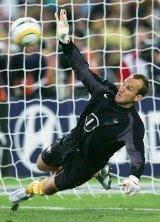 Show stopper: Socceroos goalkeeper Mark Schwarzer saves a goal in the penalty shootout.