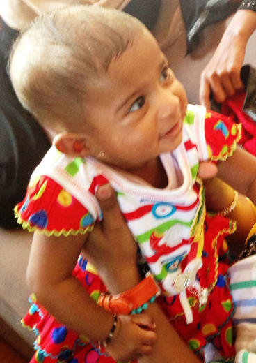An asylum seeker baby whose parents have been told they will be sent to Nauru.