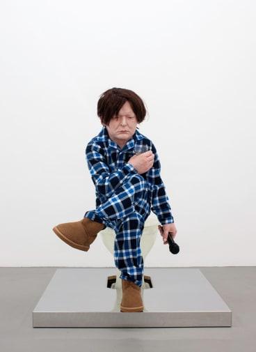 Ronnie van Hout's <i>Sitting Figure</i>.