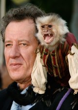 Geoffrey Rush poses with a trained monkey at the premiere of Pirates of the Caribbean film in 2007.