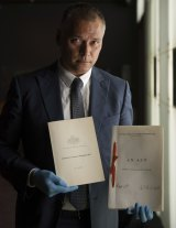 NewsStan Grant, journalist, and member of the Referendum Council examines the original Australian Constitution at the National Archives.