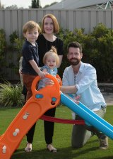 Scott and Michelle Robertson in Wagga Wagga with their kids Lila, 1, and Charlie, 3.