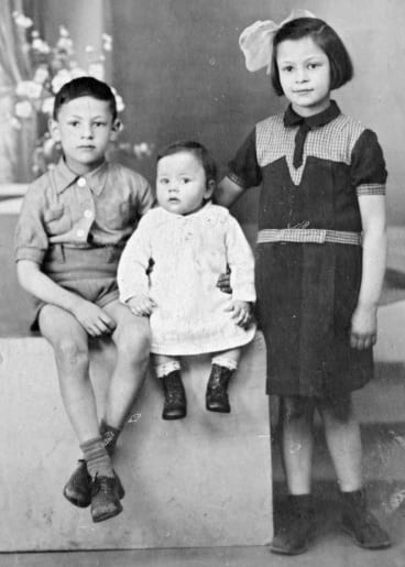Vivianne Spiegel (right) with her two younger siblings, Albert and Regine. This photo was given to their father when he was at an interment in Pithiviers, France. His family hope he had it with him when he was deported to Auschwitz.
