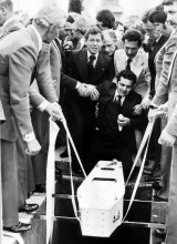 Essendon 1978: Sam Gulle is supported by friends as the body of his 4-week-old son is lowered into the grave.