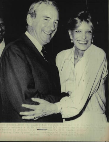 Australian Foreign Minister Bill Hayden in a friendly embrace with Melina Mercuri in Athens in 1986.
