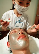 Men are increasingly being hopping on the beauty bandwagon. A man in Beijing receives treatment at the first men's beauty salon in China's capital back in 2002.