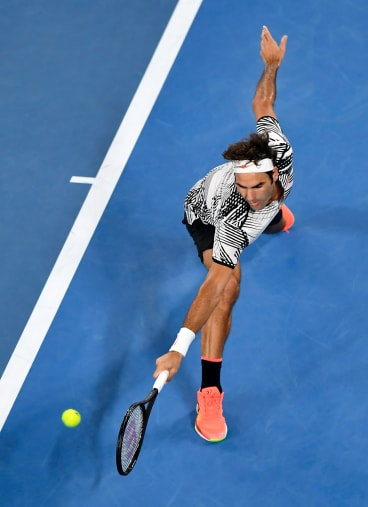 Federer stretches out for a backhand return.