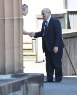Margaret Cunneen shaking hands with Eddie Obeid outside the NSW Supreme Court in Darlinghurst in February 2016.