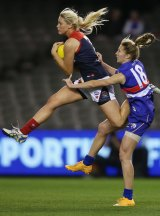 Tayla Harris takes a strong mark during the game.
