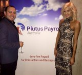 Simon Anquetil poses with former Miss World Australia Erin Holland at a Plutus Payroll event.