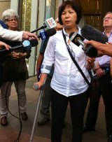 Hip implant recipient Sandy Chen outside the Federal Court.