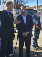 Capital Metro Minister Simon Corbell with Canberra Metro consortium chief executive Martin Pugh on Tuesday. Can the Tram protester David Dickson is in the background.