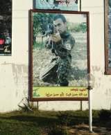 A memorial to Hezbollah fighter Abdullah Hassan Sheet on the Blue Line, the de facto boundary between Lebanon and Israel demarcated by the United Nations.