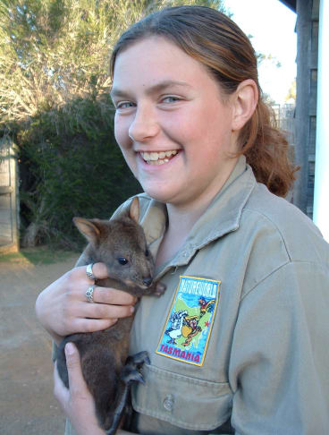 Wildlife carer Toni Bloomfield with a joey rescued from a wallaby killed on the roads.